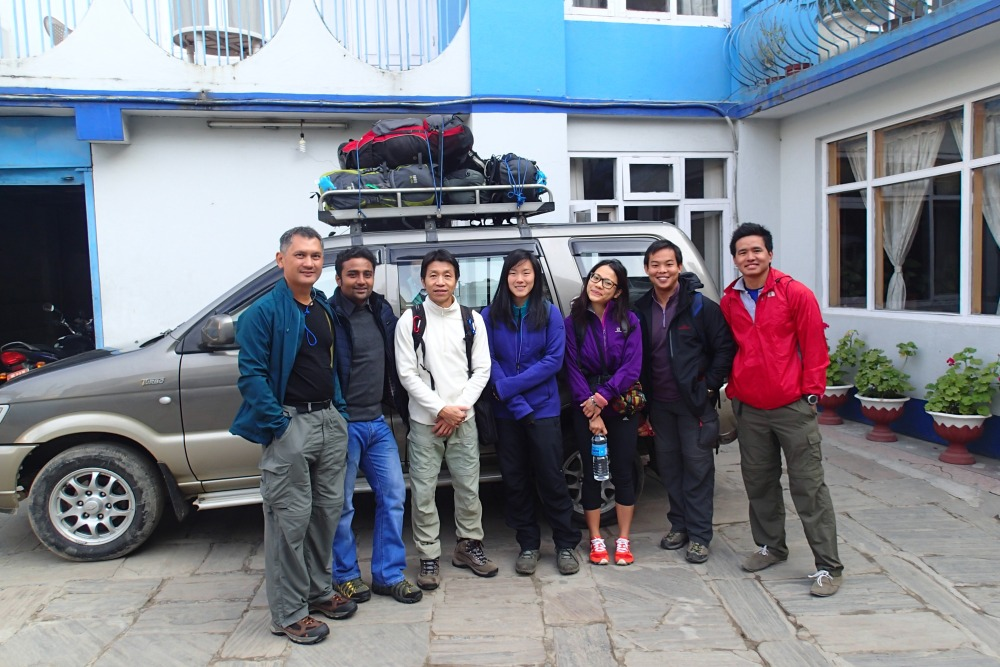 With Outfitter Nepal owner Arjun (second from the left and our guide Santosh (far right).
